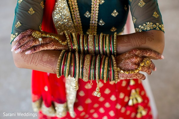 Indian bridal green, golden and red ceremony bangles.