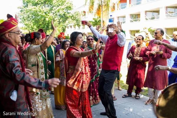 Indian wedding relatives at sangeet celebration.