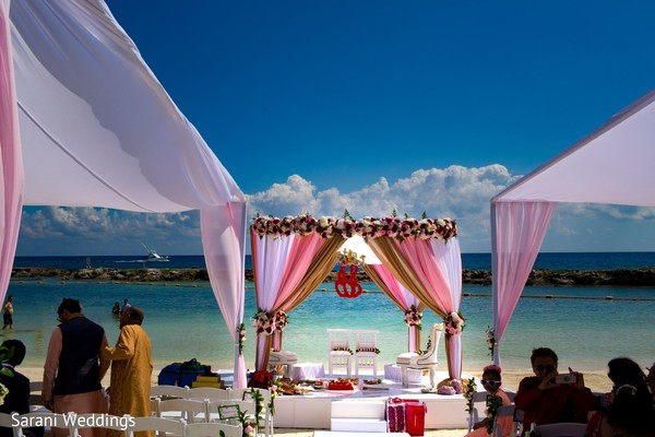 Indian wedding ceremony by the shore setup.