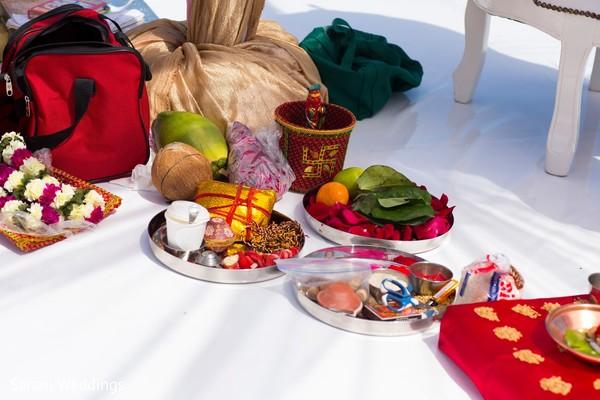 Indian wedding ritual items and garlands.