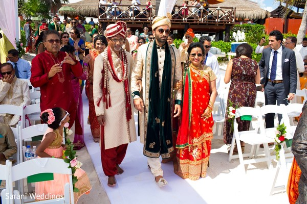 Raja walking down the ceremony aisle.