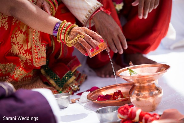 Watter and rose petals Indian wedding ceremony rituals.