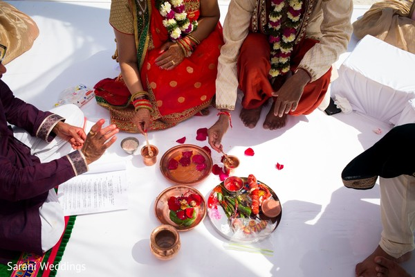 Indian relatives at the mandap during ceremony rituals.