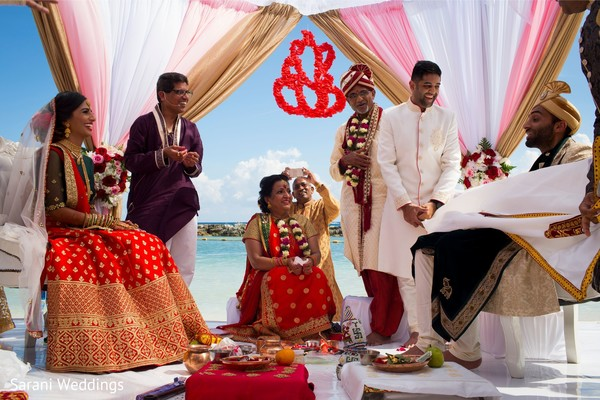 Indian groom uncovered for bride at wedding ceremony.