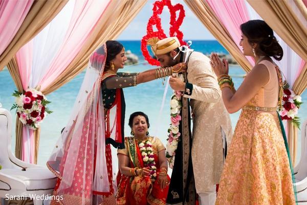 Maharani putting the garland to raja.