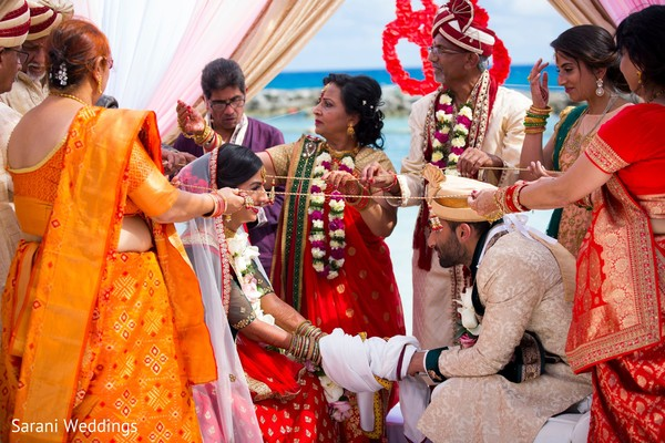 Indian couple at the wedding lasso ritual.