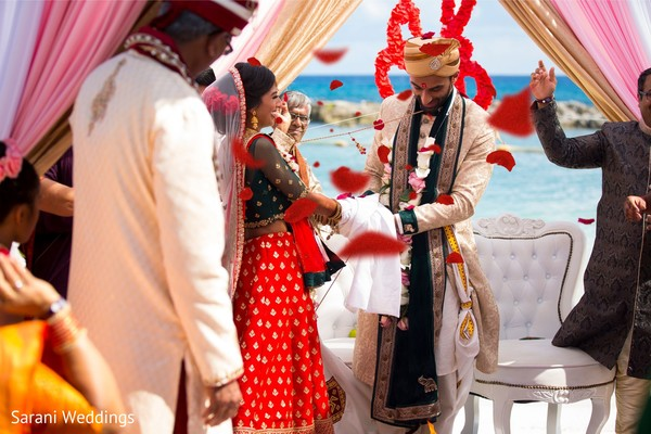 Indian bride and groom at joint of hands capture.