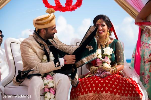 Indian groom wiping of bridal tears.