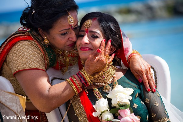 Indian bride with mother at ceremony photography.