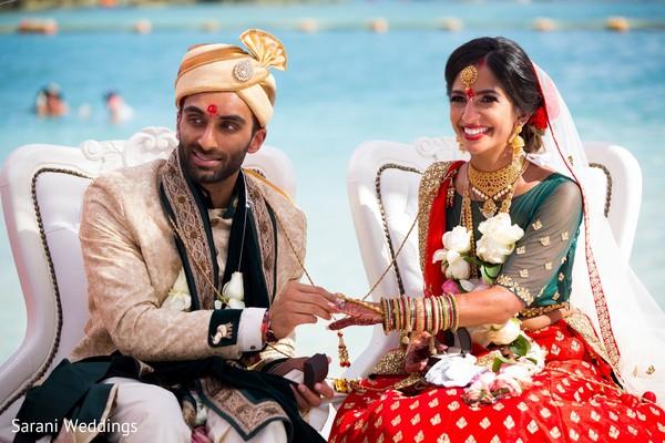 Raja putting wedding ring to maharani.