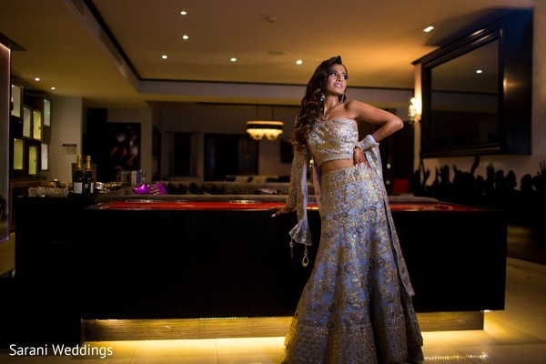 Indian bride on her reception open shirt lehenga.
