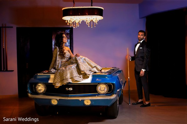 Indian bride and groom posing for reception photo session.