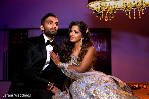 Dreamy Indian couple posing for reception photography.