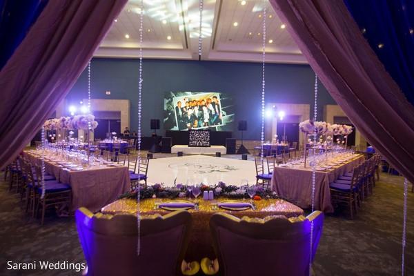 Indian wedding reception rectangle table setup.