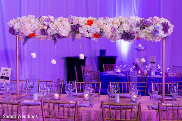 Indian wedding reception table flowers tall centerpiece.