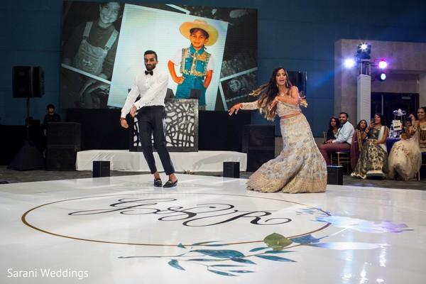 Indian couple dancing at reception dance floor.