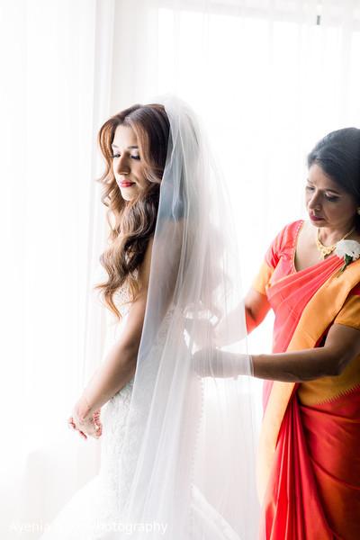 Indian relative adjusting Maharani's dress
