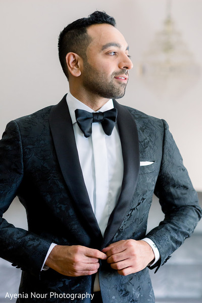 Indian groom in a black suit before the ceremony