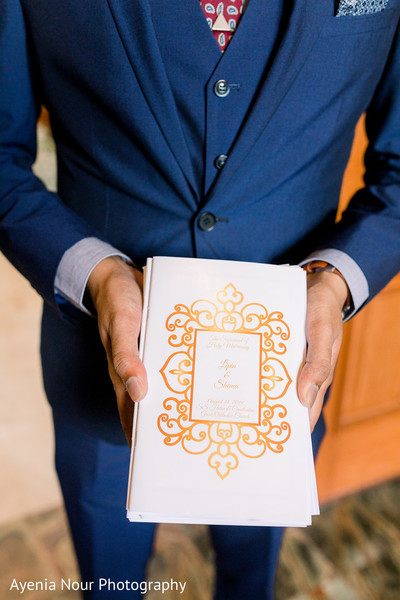 An Indian relative with the wedding programs