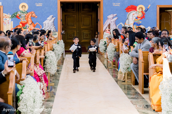 Indian page boys walking down the aisle.