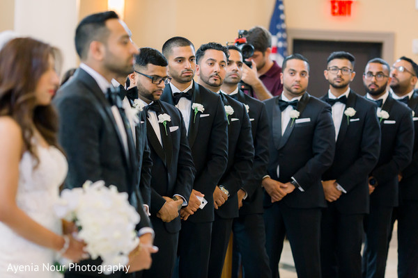 Indian groomsmen at wedding ceremony capture.