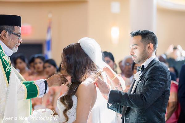 Raja putting sacred necklace to maharani.