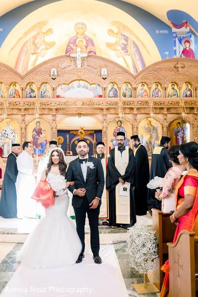 Maharani and Raja walking out of wedding ceremony.