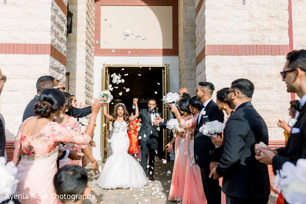 Indian couple walking out of church moment.