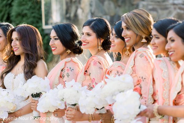 Indian bridesmaids ontheir peach colored saree.