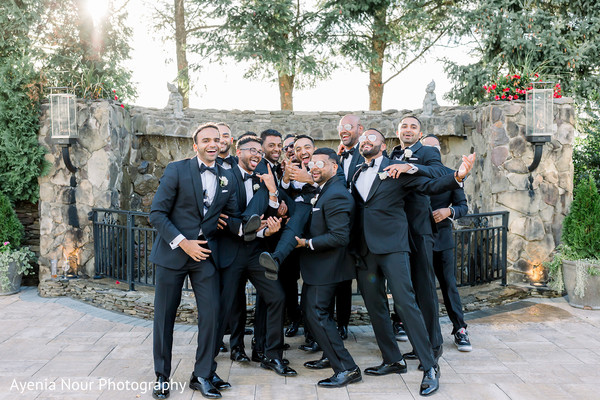 Indian groom with groomsmen posing outdoors.