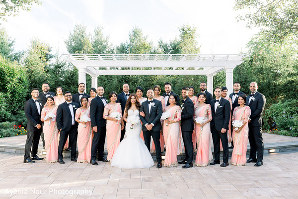 Indian couple with bridesmaids and groomsmen for photo session.