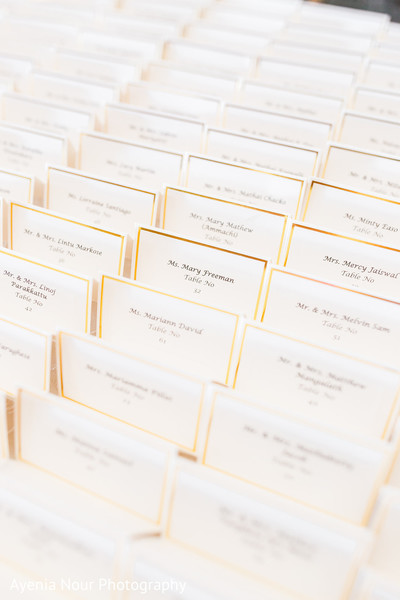 Indian wedding white with golden strip place cards.