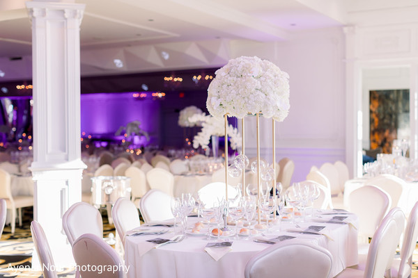 White indian wedding table flowers centerpiece.