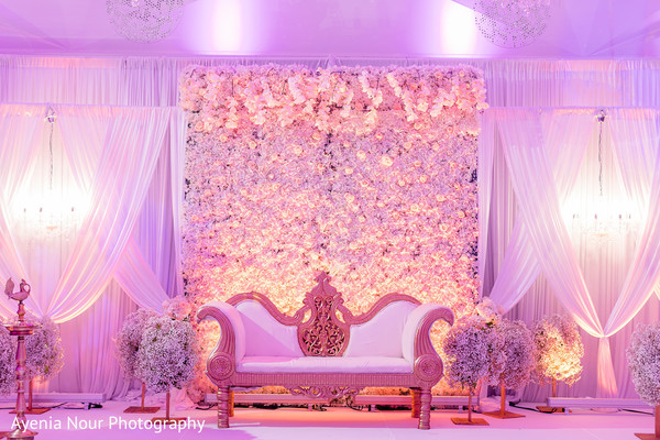 White, pink and gold Indian wedding reception stage decoration.