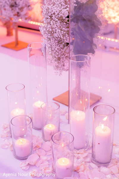 White candles on cristal tubes for Indian  stage decoration.