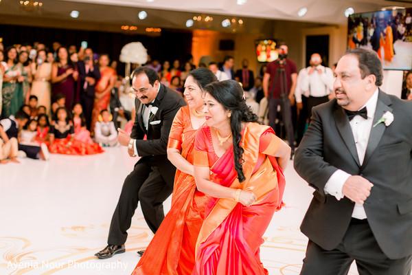 Indian wedding relatives dancing at reception.