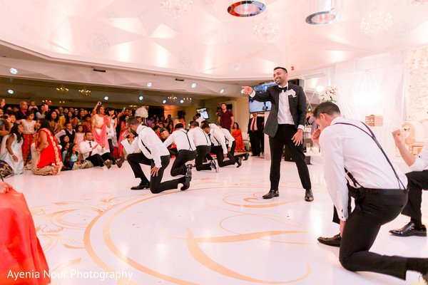 Indian groom with groomsmen at reception choreography.