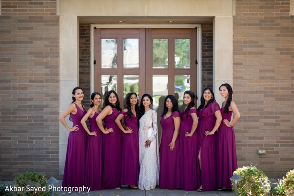 Maharani on her white lehenga with bridesmaids capture.