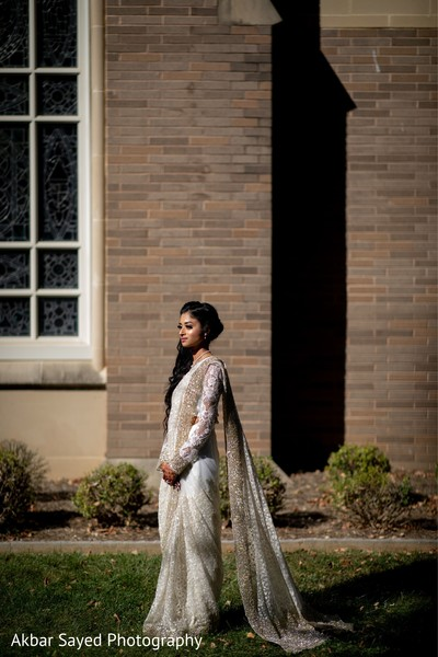 Maharani posing outdoors on her ceremony lehenga.