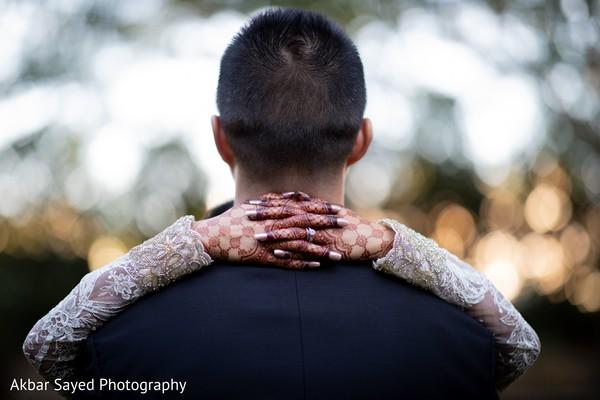 Indian bride hugging groom photography.