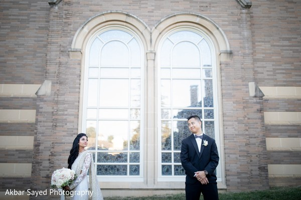 Indian Bride and groom looking at each other.