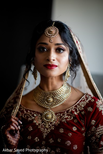 Indian bride wearing her ceremony jewelry.