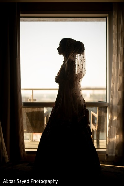 Indian bridal next to window capture.