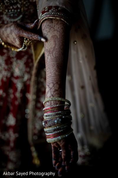 Indian bride showing her mehndi art.