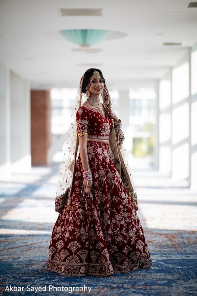 Indian bride wearing on her red lehenga.