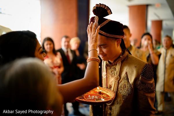 Indian groom during the milni ritual.