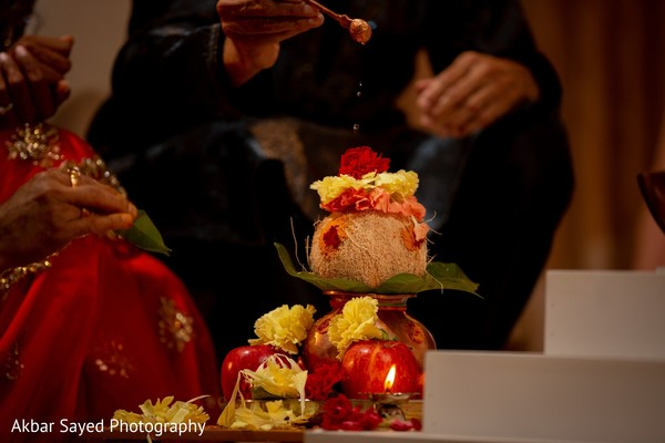 Indian wedding traditional coconut ritual.