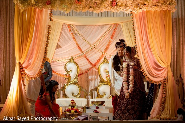 Indian bride and groom tying the knot ritual.