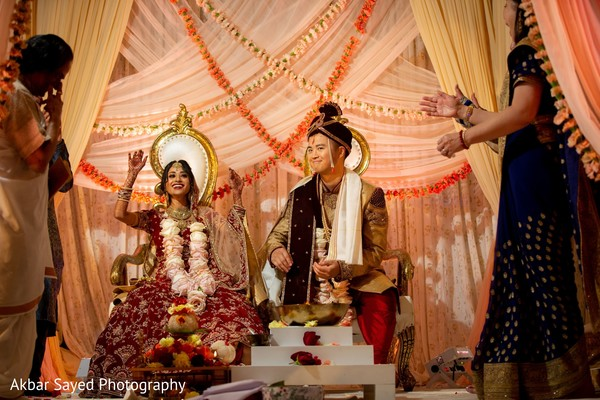 Indian Bride and groom at traditional wedding game.