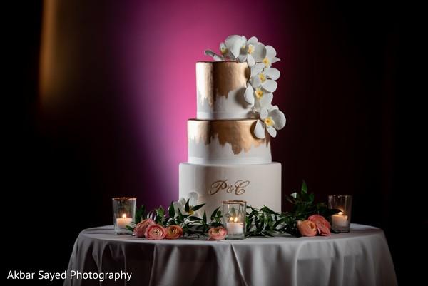 white and golden Indian wedding cake decoration.